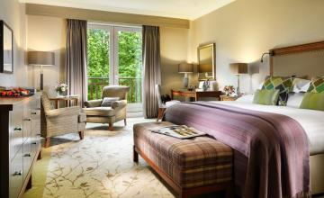 Druids Glen Hotel & Golf Resort: 1 or 2 Night B&B in a Deluxe Room with Dining Credit, Spa or Golf Credit, a Bottle of Prosecco & Late Check Out for 2 People (40% OFF)